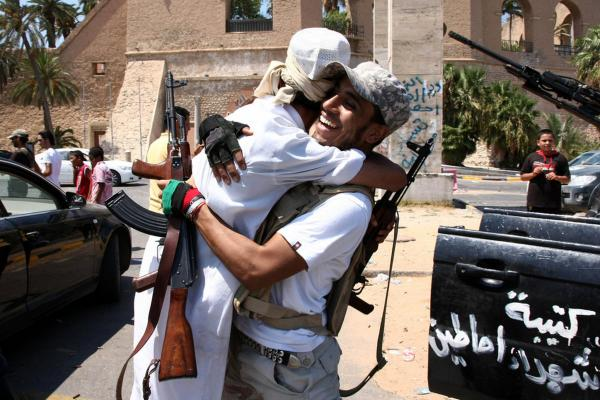 Libyan rebel fighters celebrate in the newly named Martyr's Square, formerly known as Green Square, in Tripoli.