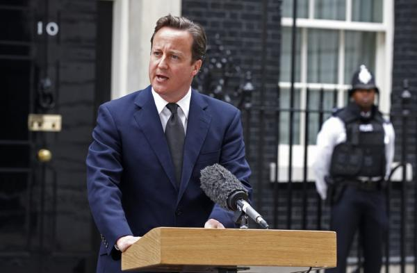 British Prime Minister David Cameron addresses the media in London on Aug. 8. Cameron announced the recall of Parliament from its summer recess to deal with the crisis.