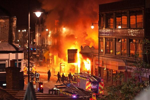 Buildings burn on Tottenham High Road in the North London suburb. A peaceful protest against Duggan's killing escalated into a riot on Aug.6.