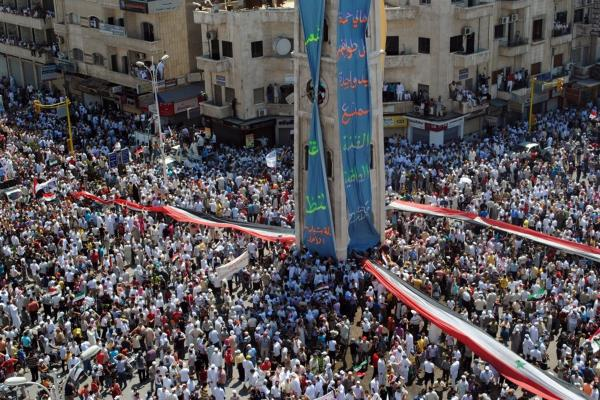 Syrians in the city of Hama staged a mass demonstration against the government on Friday, July 29, as seen in this photo provided to AFP by a third party. Two days later, the Syrian military launched a fierce crackdown in the city.
