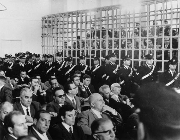 More than 150 suspected Mafia members are packed into an improvised cage in the gymnasium of Aldisio Grade School in Catanzaro, Italy, as they went on trial in 1967 for about 100 murders in Palermo. The courtroom was too small to hold them. Cages were also used in Italian trials of alleged Mafioso and of Red Brigade terrorists in the 1980s.