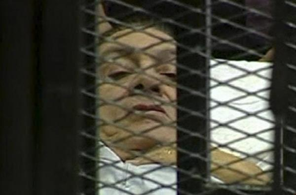 Former Egyptian President Hosni Mubarak lies on a hospital bed inside a bars-and-mesh defendant's cage in a Cairo courtroom as he went on trial Wednesday on charges of corruption and ordering the killing of protesters. Although such cages aren't unusual in many countries, the televised images of Mubarak shocked people in Egypt and around the globe.