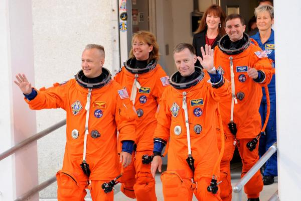 The crew of the final shuttle mission includes: Commander Chris Ferguson (right, front), pilot Doug Hurley (left, front), followed by Mission Specialists Sandy Magnus (left, rear) and Rex Walheim (right, rear).