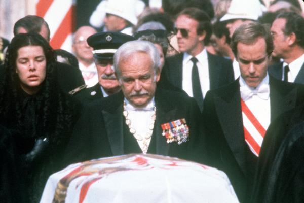 In 1982, Princess Grace was fatally injured in a car accident. Prince Albert (right) and Princess Caroline escort their father as they follow the coffin to her funeral service.