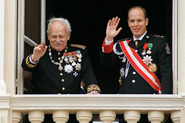 Rainier and Albert salute citizens from the palace balcony during National Day ceremonies in November 1997. Albert took the throne of the Mediterranean principality following his father's death in April 2005.