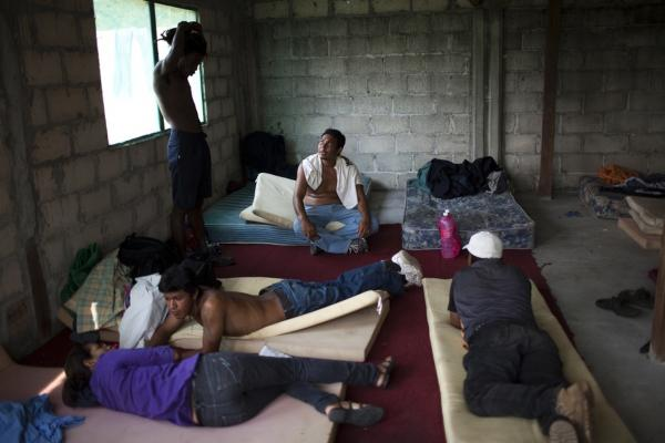 Migrants relax in a shelter in Tenosique, the starting point for many Central American migrants who will travel through Mexico on top of freight trains.
