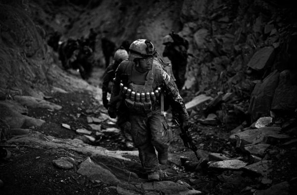 Soldiers with Butcher Troop, part of the U.S. Army's 1st Infantry Division, and Afghan National Army troops climb the treacherous mountains overlooking the Khost-Gardez highway while on a mission to disrupt insurgent fighters in the area.