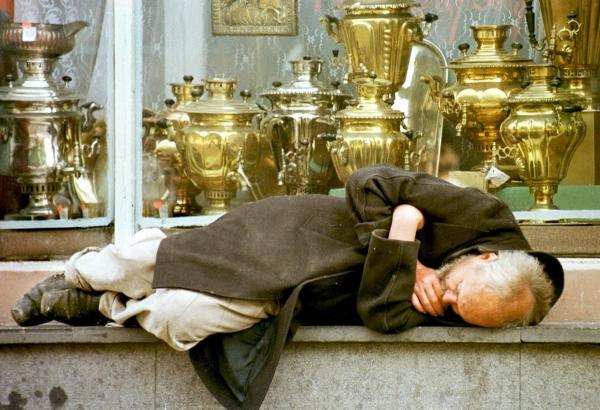 <b>RUSSIA, defaulted in 1998. </b> A homeless man sleeps in the window of an antiques shop on downtown Moscow's Arbat street. Although Prime Minister-delegate Yevgeny Primakov had said during Russia's ruble crisis that reform was at the top of his economic priorities, the country ultimately defaulted.