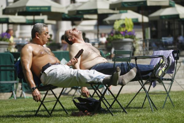 Sunbathers bask in New York City's Bryant Park on Wednesday. Authorities blamed the heat for the recent deaths of five elderly people in Tennessee, Maryland and Wisconsin.