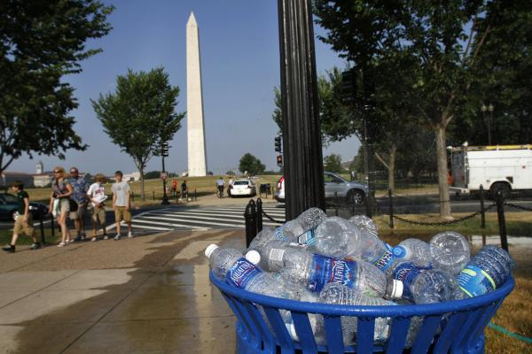 A recycling bin overflows with discarded water bottles on the National Mall in Washington, D.C.