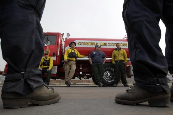 Firefighters gather for an after action review after battling the Wallow Fire in Eagar on Wednesday. Around 2,500 firefighters, many from surrounding states and as far away as New York, are working to contain the fire.