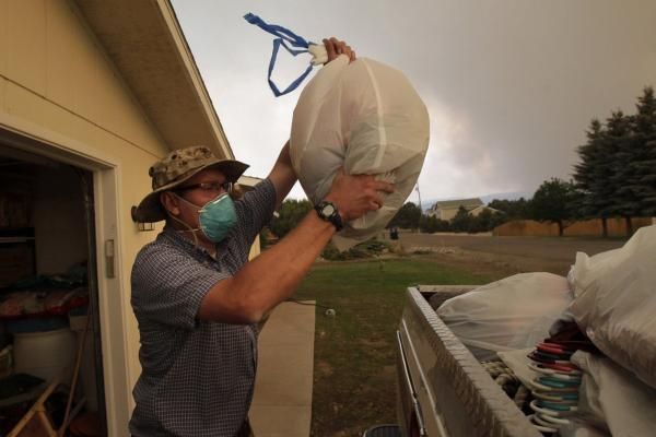 Scott Shellenberger, 32, packs his belongings during a mandatory evacuation in Eagar on Tuesday. About half the town's 4,000 residents evacuated as surrounding towns also prepared to empty.