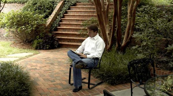 During the 2004 presidential campaign, John Edwards worked in the backyard of his home in Raleigh, N.C., while awaiting his upcoming speech to the Democratic National Convention.