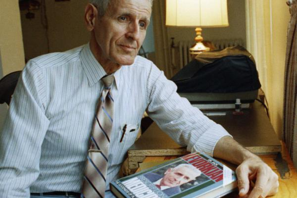 Kevorkian with his book <i>Prescription: Medicide</i> in 1991. Critics and supporters generally agree that his advocacy for the right of the terminally ill to choose how they die brought changes to hospice care in the United States.