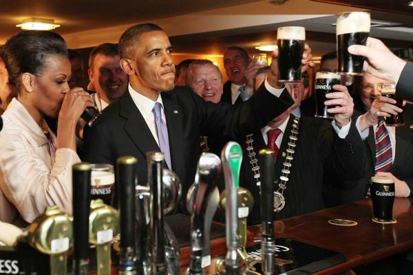 President Obama and first lady Michelle Obama sample a glass of Guinness on Monday in Moneygall, Ireland.