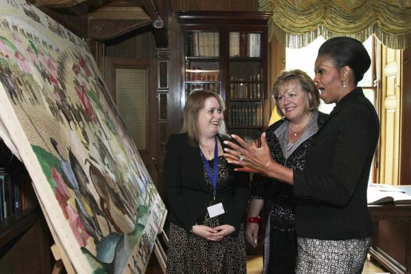 First lady Michelle Obama and Fionnuala Kenny (center), the wife of Irish Prime Minister Enda, view an embroidered panel depicting the Norman Invasion, during a tour of Farmleigh House in Dublin.