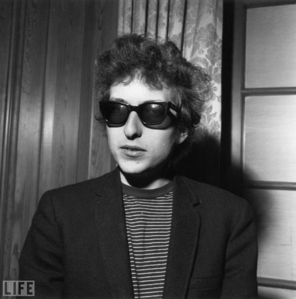 "Dylan sports shades in London in April 1965. In March of that year he had made his first move toward electric instruments when he released ""Subterranean Homesick Blues."""