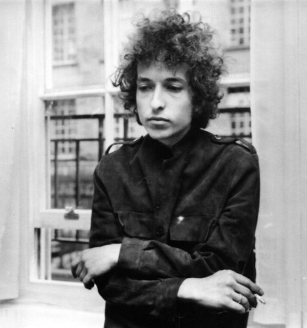 Dylan at a London press conference. The previous summer, his first electric concert — at the Newport Folk Festival — prompted boos from the audience, and he left the stage after only three songs.