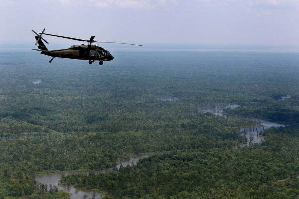 MAY 12: A Black Hawk helicopter carrying Louisiana Gov. Bobby Jindal flies over the Atchafalaya Basin in Louisiana during a tour of areas that may be affected by flooding if the Morganza Spillway north of Baton Rouge is opened.