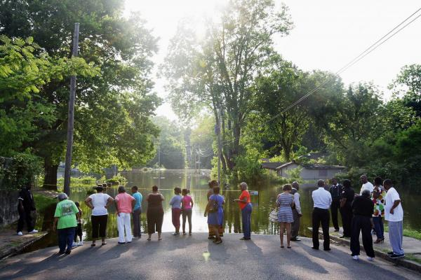 MAY 8: Residents gather at the edge of the floodwaters in the West Junction neighborhood of Memphis.
