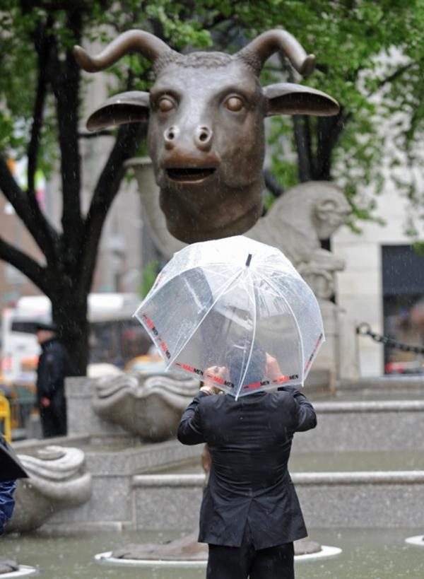 "A man photographs ""Circle of Animals/Zodiac Heads."" Ai's work comprises 12 monumental bronze animal heads representing the 12 animals of the Chinese zodiac."