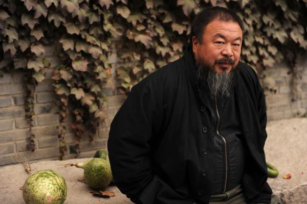 Ai Weiwei sits in the courtyard of his home in Beijing while under house arrest Nov. 7. Ai is one of China's most famous artists and social critics.