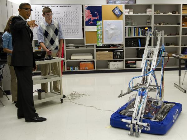 Students show President Obama inventions they entered in a robotics competition at Thomas Jefferson High School for Science and Technology in Alexandria, Va., last September.