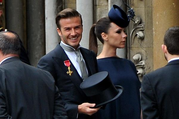 Soccer player David Beckham and his wife, designer Victoria Beckham, arrive at Westminster Abbey.