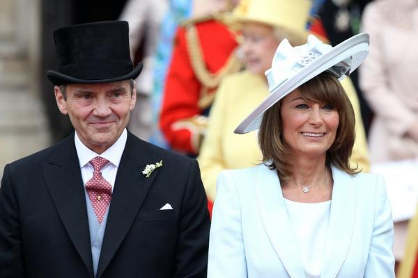 The bride's parents, Michael and Carole Middleton, smile at the crowds after the wedding ceremony.