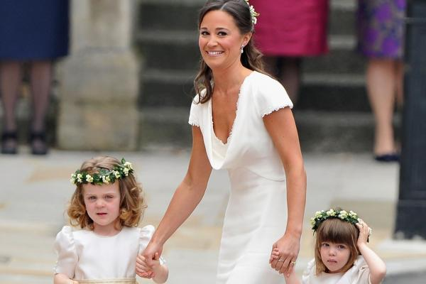 Sister of the bride and maid of honor Pippa Middleton escorts the younger bridesmaids to Westminster Abbey.