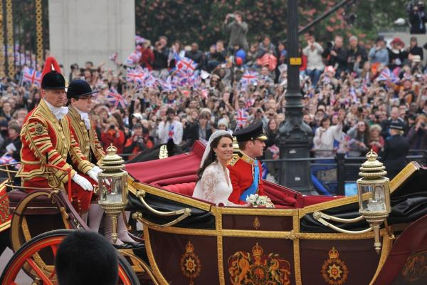 The newlyweds travel in the 1902 State Landau carriage to Buckingham Palace.
