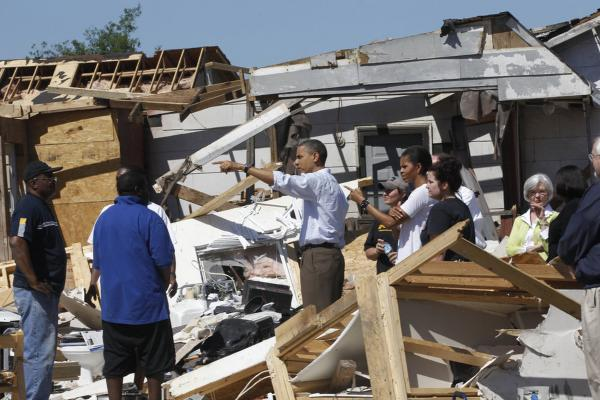 President Obama and first lady Michelle Obama tour tornado damage in Tuscaloosa, Ala., on Friday.