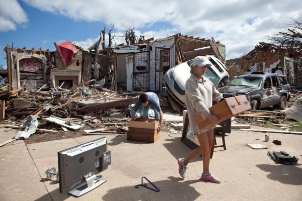 Kelly Giddens (right) helps University of Alabama law student Daniel Hinton remove belongings from his destroyed home in the Cedar Crest neighborhood of Tuscaloosa.