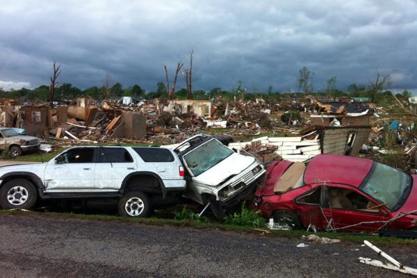 Destroyed cars line the streets of Pleasant Grove.