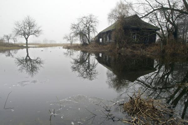 The April 26, 1986, accident at the Chernobyl nuclear power plant created ghost towns in Ukraine. Tens of thousands of people were evacuated from surrounding areas. Dozens of villages and properties remain empty, like this abandoned house, seen in 2006, in the deserted village of Redkova, about 22 miles from the plant.