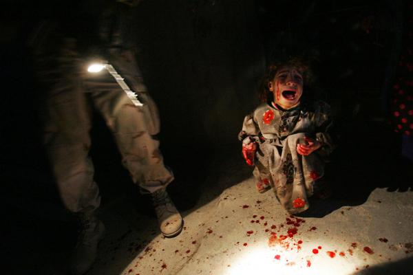 Samar Hassan, 5, screams after her parents were killed by U.S. soldiers with the 25th Infantry Division in a shooting in Tal Afar, Iraq, on Jan. 18, 2005. The troops fired on the Hassan family car when it unwittingly approached them during a patrol in the tense northern Iraqi town. Parents Hussein and Camila Hassan were killed instantly, and a son Racan, 11, was seriously wounded in the abdomen. Racan, paralyzed from the waist down, was treated later in the U.S.