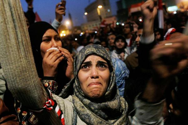 A woman in Tahrir Square cries after it was announced that Egyptian President Hosni Mubarak was giving up power, Feb. 11.