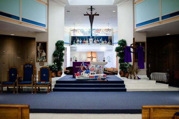 On the morning of this year's boat blessing, St. Joseph's Catholic Church held a special Mass — complete with a miniature shrimp boat on the altar.