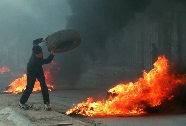 In the late 1990s, both Marinovich and Silva traveled to the Middle East to photograph ongoing clashes in the region. Silva captured this young Palestinian boy throwing a tire in the West Bank town of A-Ram in March 1997.