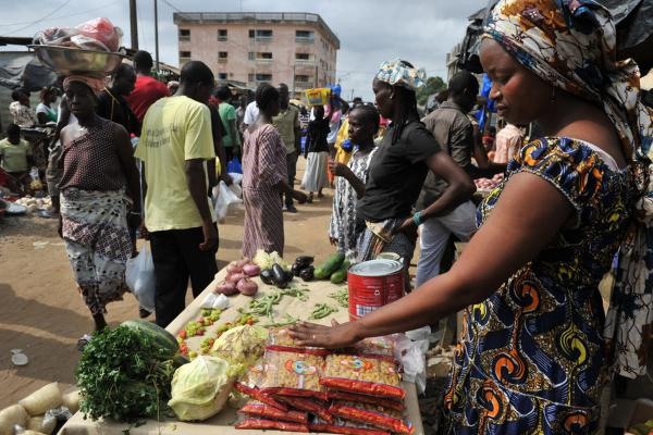 Women sell goods at a market in Abidjan's Abobo suburb on Thursday, a sign that life in that part of the city was starting to return to normal. Fighting had shifted to the nearby, upmarket neighborhood of Cocody.