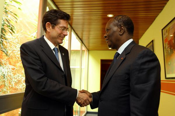 Ouattara (right) held a meeting with the U.N. assistant secretary-general for human rights, Ivan Simonovic, on Thursday. The U.N. said Friday that it had found more than 100 bodies in several western cities.
