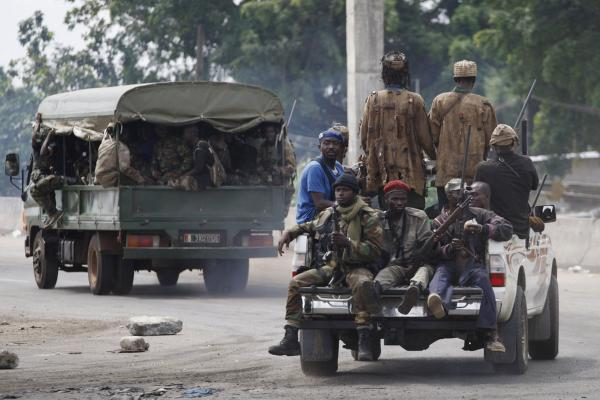 Soldiers loyal to Ouattara head for battle on Wednesday. Their forces have reportedly fired on a bunker in the presidential compound where Gbagbo has taken shelter.