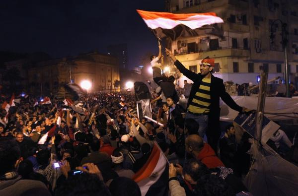 Egyptians celebrate in Tahrir Square after hearing the news of the resignation of President Hosni Mubarak on Friday.