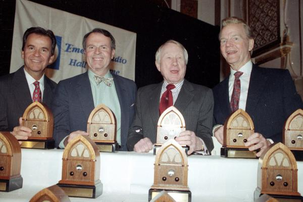 The eternally youthful Clark shares the stage at the Emerson Radio Hall of Fame in 1990 with fellow inductees (from left) Charles Osgood, Frank Stanton and Paul Harvey.