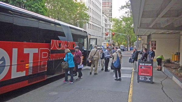 Passengers board a Boltbus headed to Seattle outside a parking garage in downtown Portland. Photo by Chris Lehman