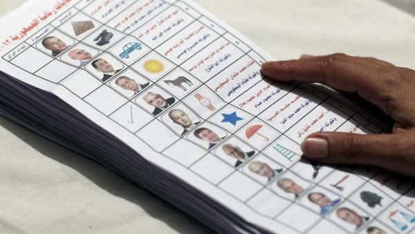 An Egyptian election official counting ballots from the presidential election.