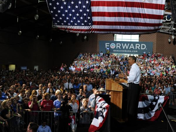 President Obama tossed a cowpie charge at Republican Mitt Romney, May 24, 2012, in Des Moines, Iowa.
