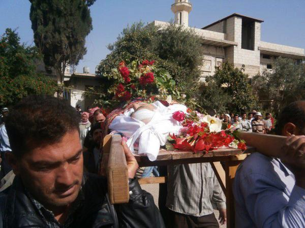 A handout image released by the Syrian opposition's Shaam News Network on Wednesday, shows Syrians carrying the coffin of Suleiman Kharma who was allegedly killed by security forces during the unrest in Qusayr in central Homs province.