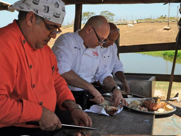 Pernot (center) cooks up a special dish.