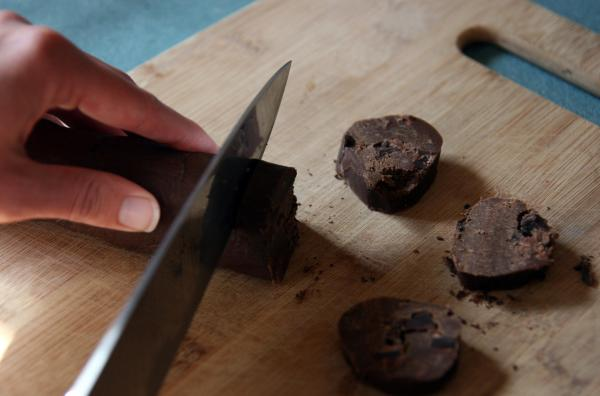 The refrigerated logs of dough are sliced into half-inch rounds. The cookies can be sprinkled with salt before baking.
